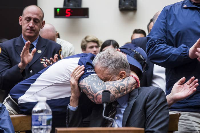 FealGood Foundation cofounder John Feal hugs former Daily Show host Jon Stewart during a House Judiciary Committee on Capitol Hill, June 11.