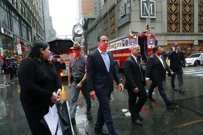 New York Gov. Andrew Cuomo walks near where a helicopter crash-landed on top of a building in Midtown Manhattan, June 10.