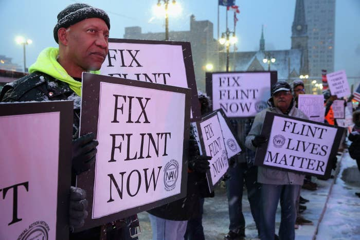 Demonstrators outside the Fox Theatre before a Republican presidential debate March 3, 2016, in Detroit.