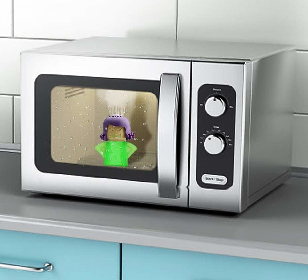 The microwave cleaner is actually a small bottle shaped like a woman's shoulders and head. Her head has tiny holes where the cleaning concoction will spurt from to clean the microwave. It's sitting inside of a microwave.