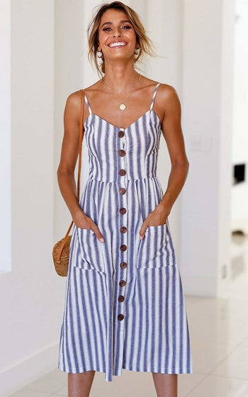 A model wearing the spaghetti-strap dress in blue and white stripes