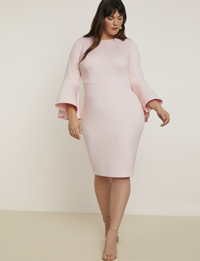 a model in a pink dress with trumpet sleeves