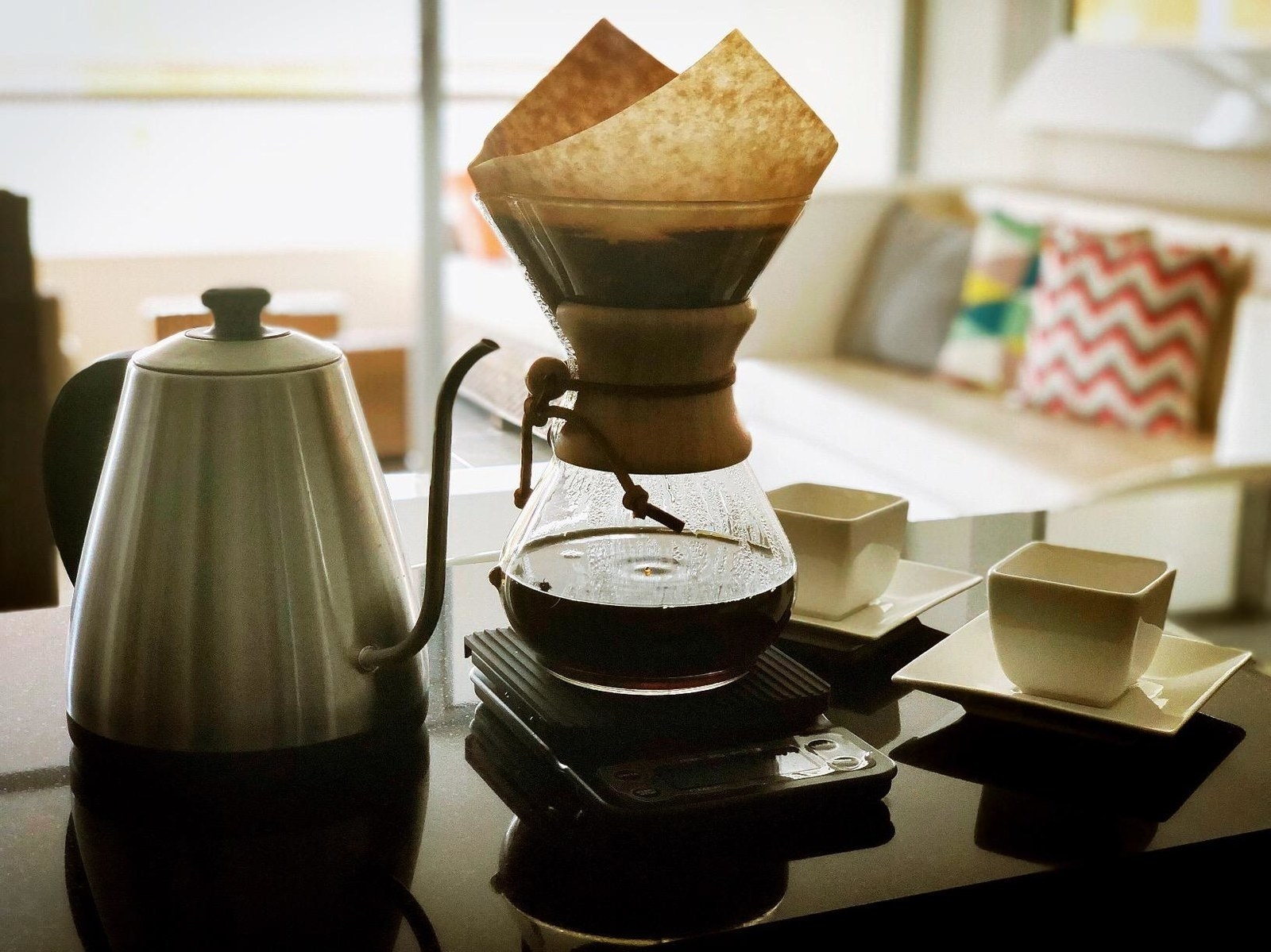 Pour-over coffee being made in the hourglass-shaped Chemex