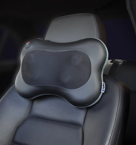 Neck massager attached to driver's seat in a car