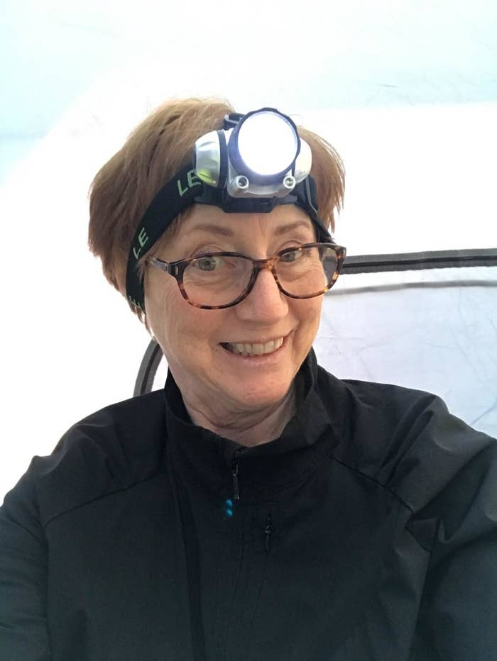 reviewer wearing illuminated headlamp
