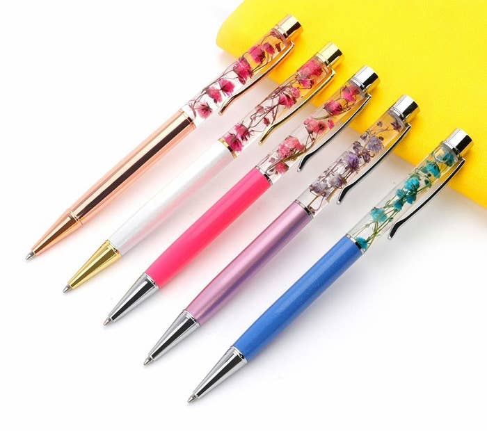 The pens, in rose gold, white, hot pink, purple, and blue