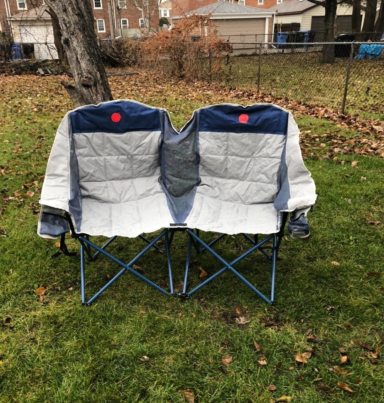 camping chair that looks like two camping chairs melded together with no middle arm rests