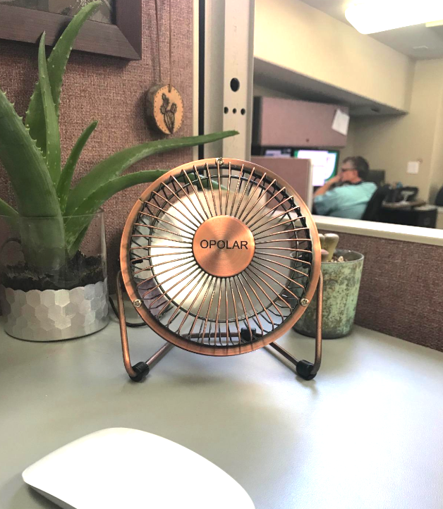 Reviewer image of the tiny fan on a desk