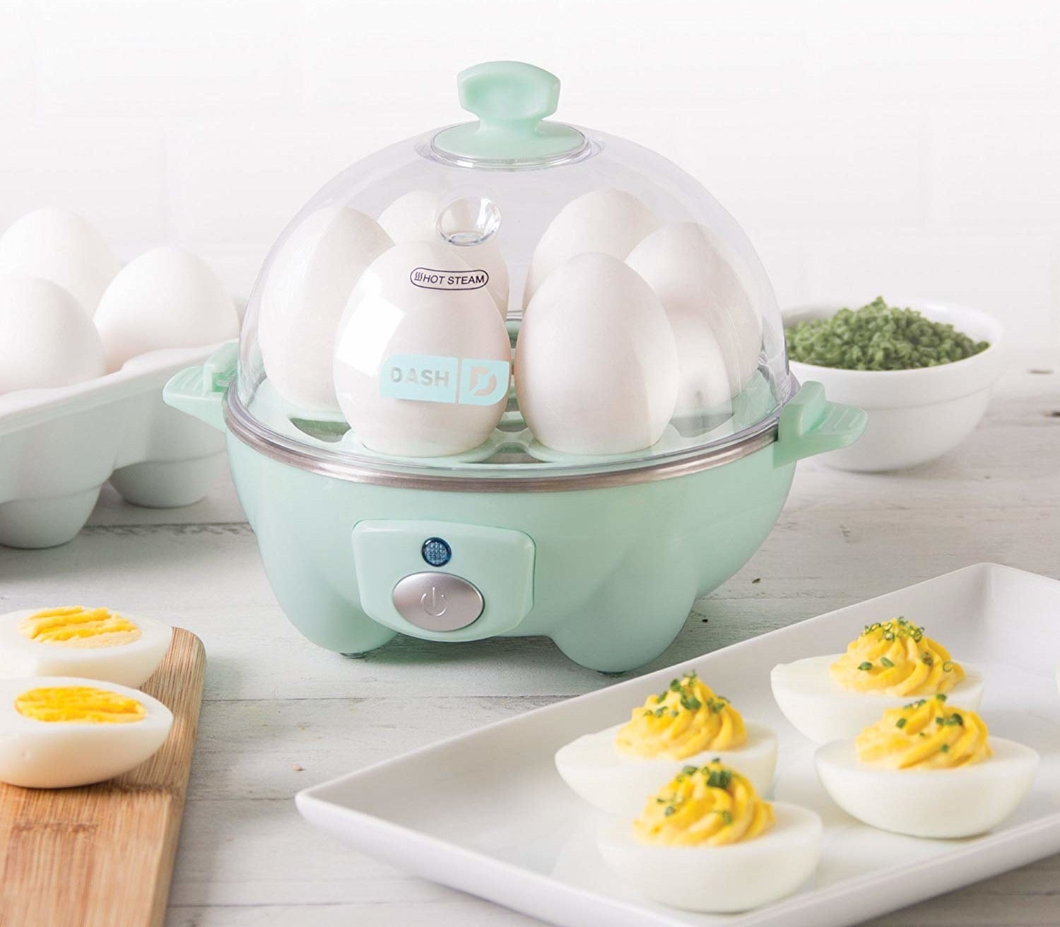 The dome-shaped egg cooker in aqua