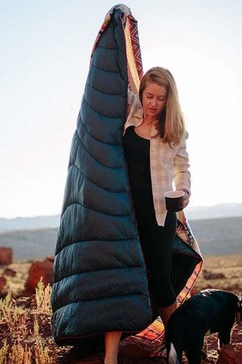 model holding blanket outdoors