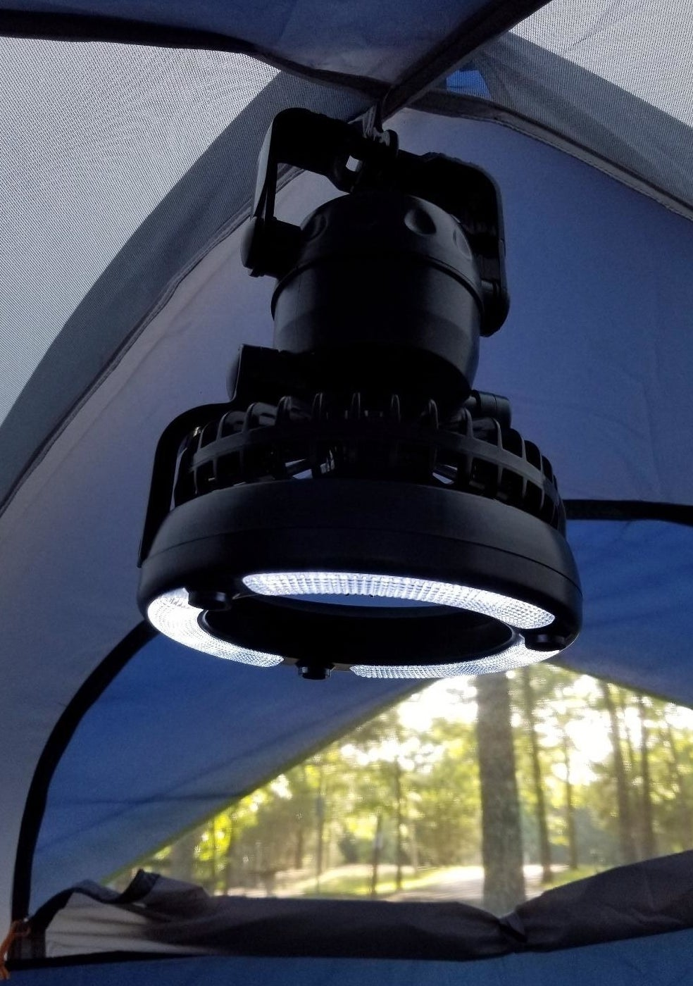 light and fan combo hanging inside a tent