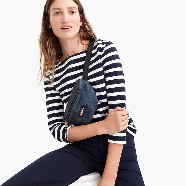 Model wearing three-quarter sleeved shirt in navy stripes