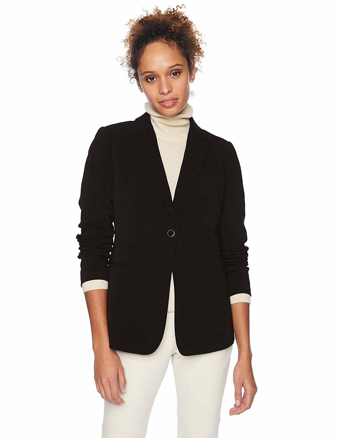 Model wearing boyfriend blazer with one button closure and welt pockets on either side