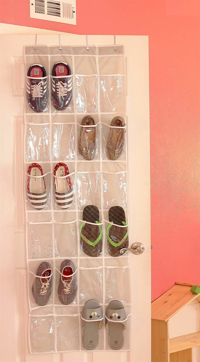 The organizer with clear pouches hanging on the back of a door. It has enough space for 12 pairs of shoes