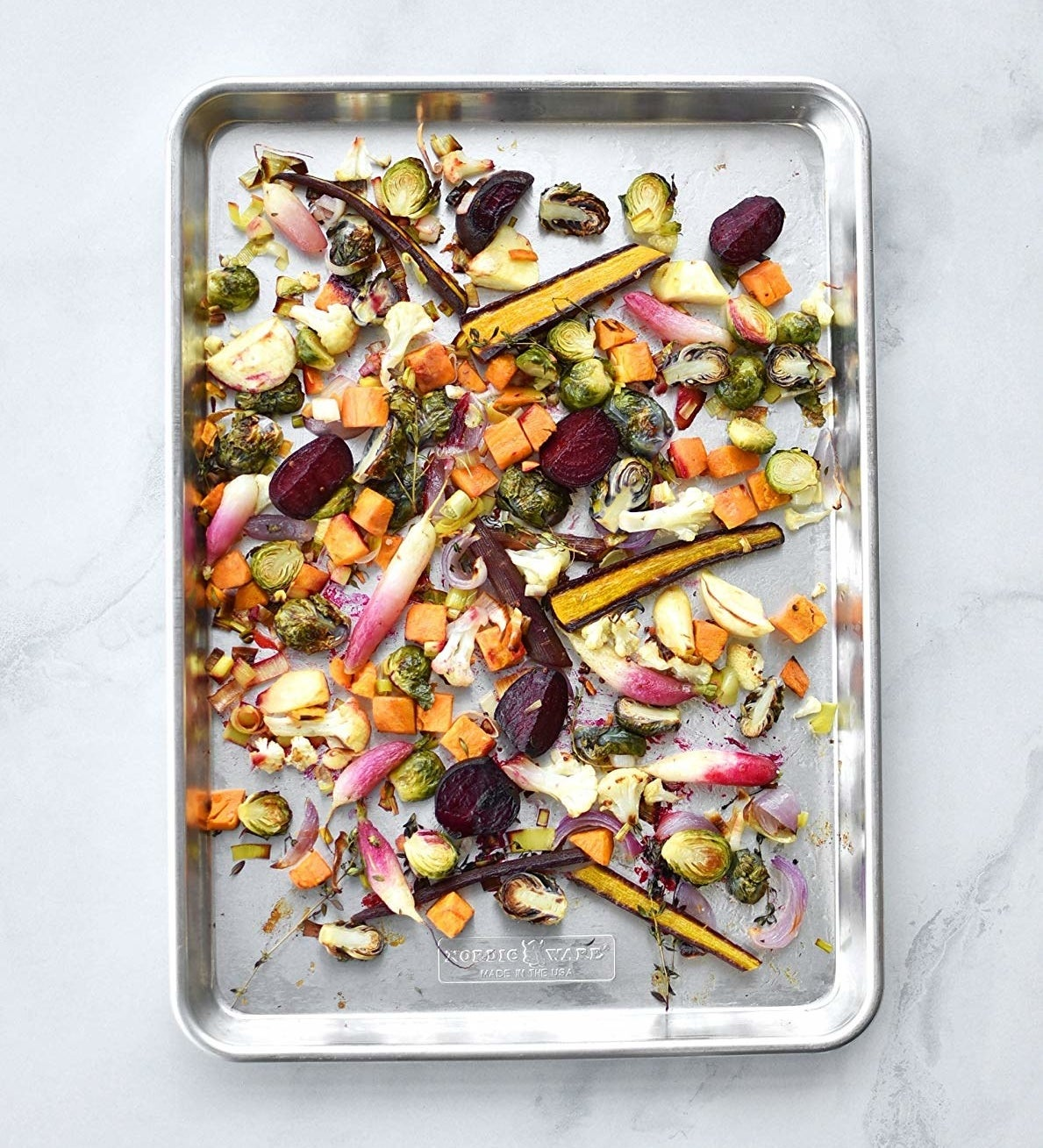 silver sheet tray of roasted mixed vegetables