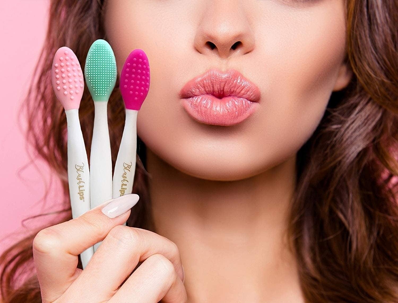 Model holding the lip brushes
