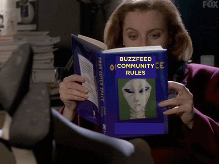 """a woman holds a book with an alien on the front that says """"Buzzfeed community rules"""""""