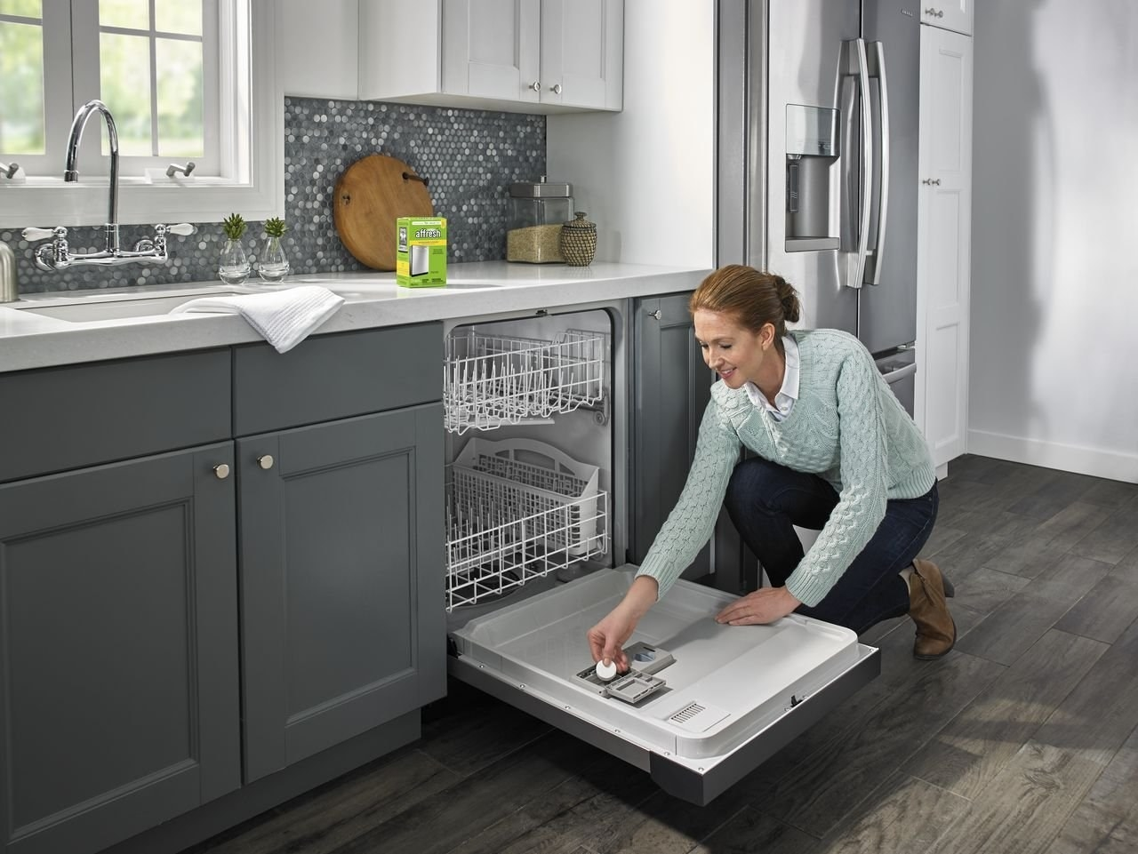 Model placing a tablet in the dishwasher