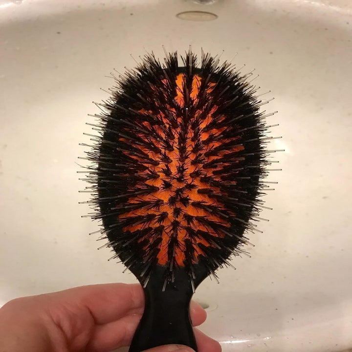 After: the same brush, now clean so you can see the red base that holds the bristles