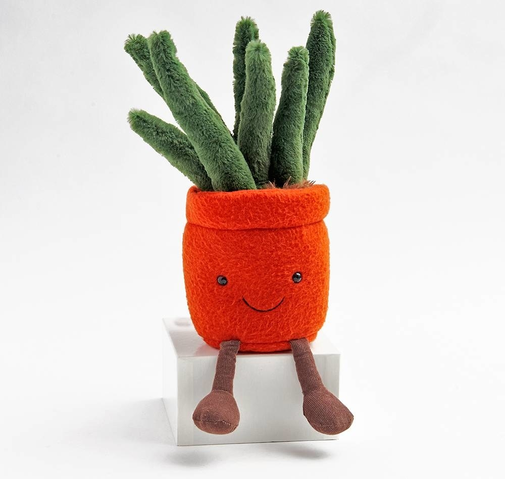 plush potted plant with small on pot and two legs