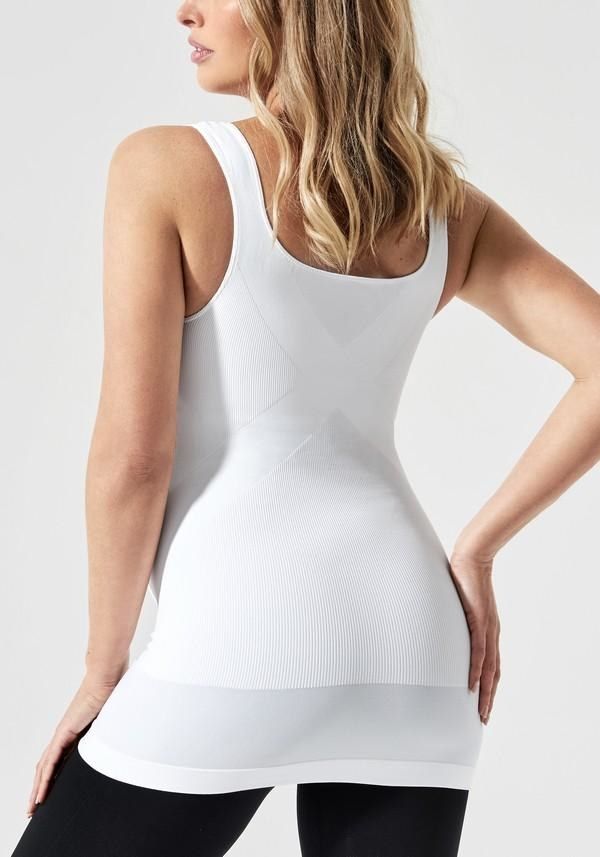 a283626fba853 A tank top with a built-in (but invisible) belly support band and x-shaped  back reinforcement so your hips can get the extra assist that they  desperately ...