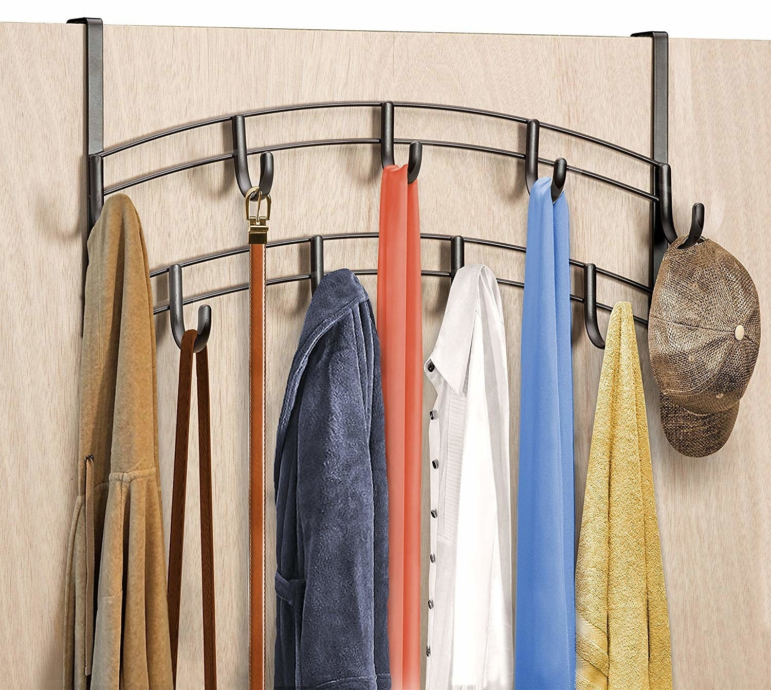 The nine-hook rack over the door with assorted sweatshirts, shirts, towels, and accessories hanging on it
