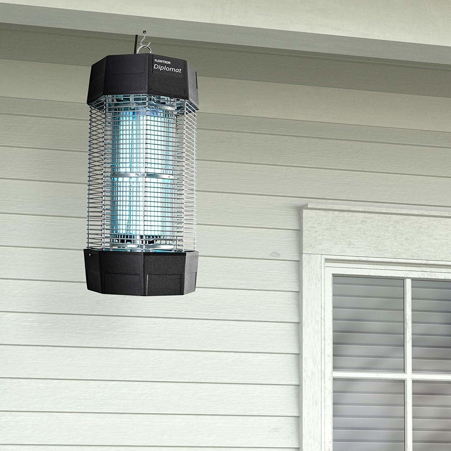 lantern-iike bug zapper hanging up on porch roof