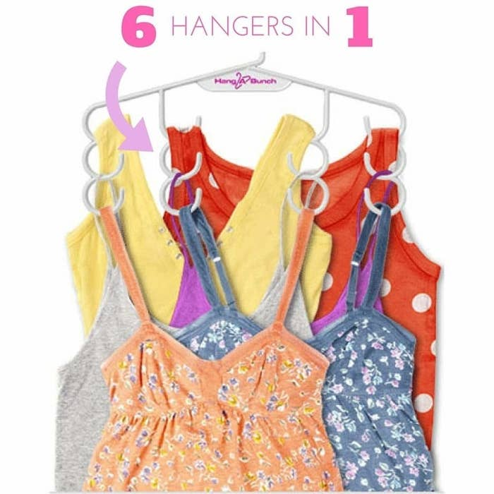The hanger in white with six camis and tank tops on it