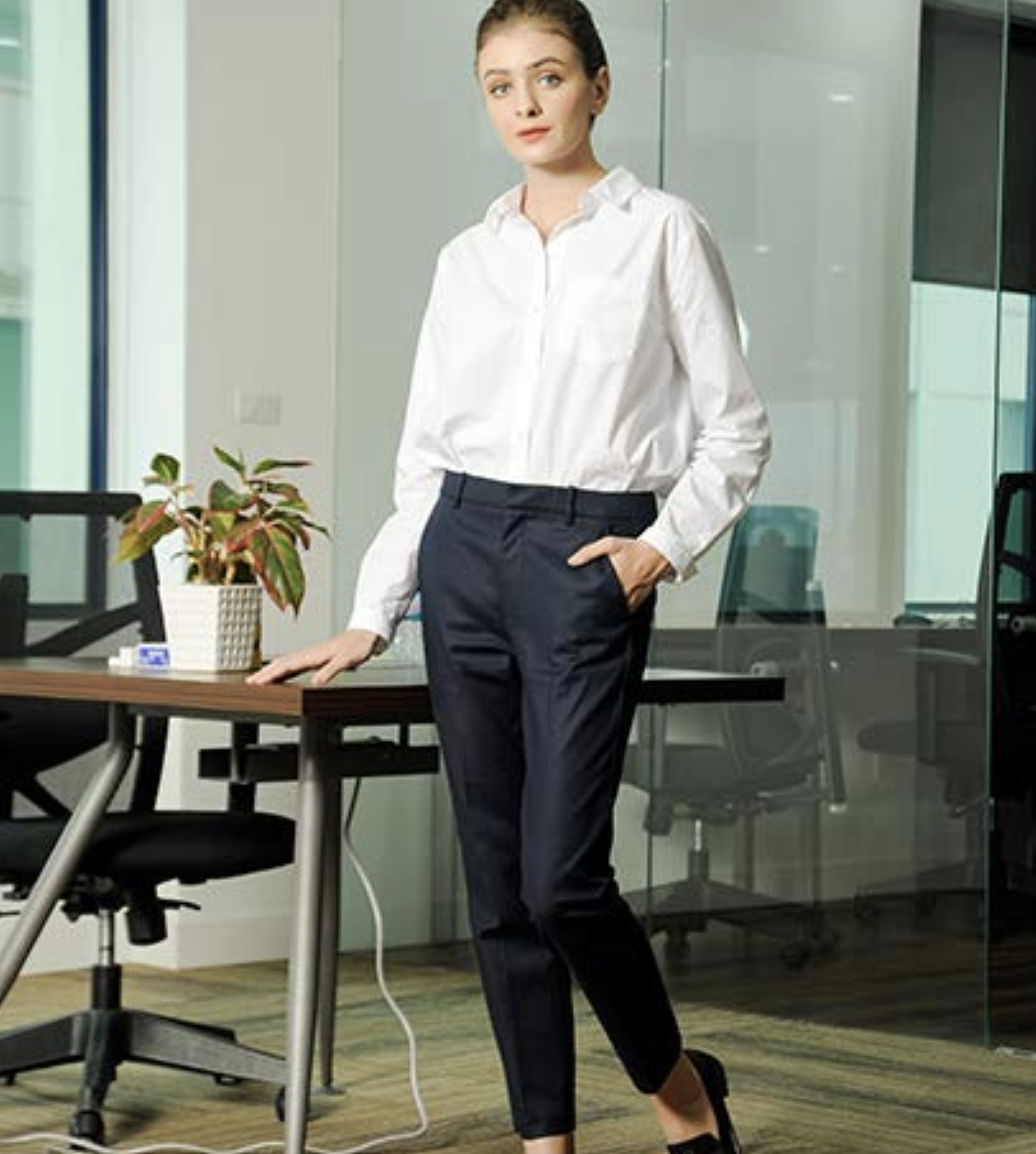 Model wearing the pants in navy with cigarette-style leg in an office