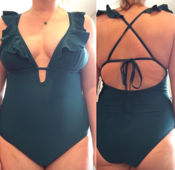 reviewer wearing the dark green swimsuit with a ruffle V-neck top and a strappy racerback