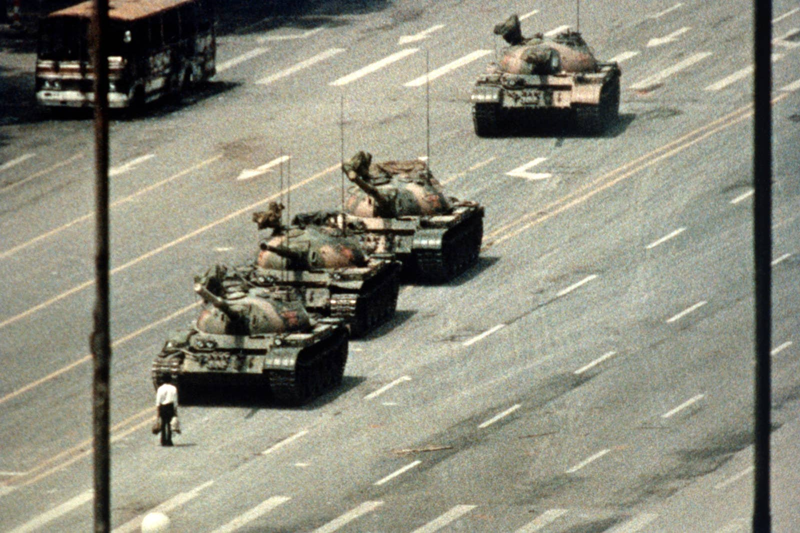A Beijing demonstrator blocks the path of a tank convoy along the Avenue of Eternal Peace near Tiananmen Square.