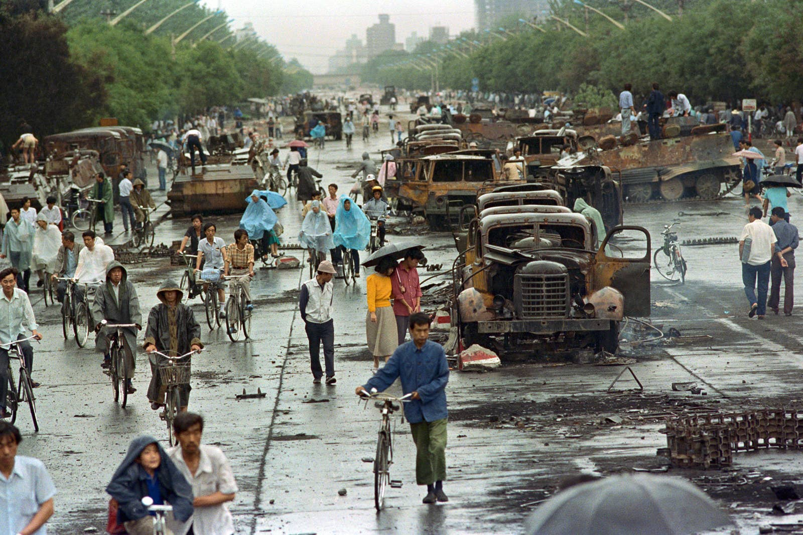 Beijing citizens walking through Tiananmen Square in the aftermath of the riots.