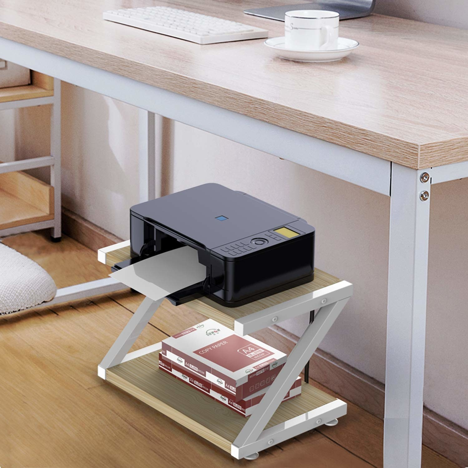 A two-tier shelf with a printer on the top shelf and a stack of paper on the bottom shelf under a desk