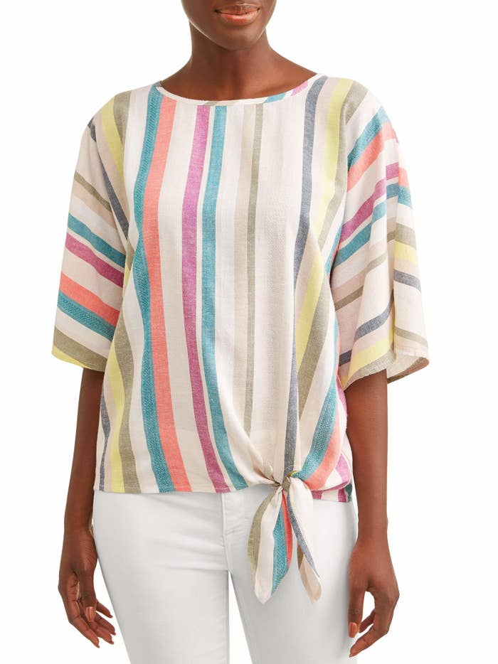 """Promising review: """"Very cute top. I never wear shirts with such a flowy feel but it hangs on my body (5'3) very well! I normally wear a L-XL in tops and I got a medium in this one because the larger sizes were just far too large. Super cute with jean capris or white capris for summer."""" —TiffPrice: $13.96 (available in sizes S-XXL and seven colors/prints)"""