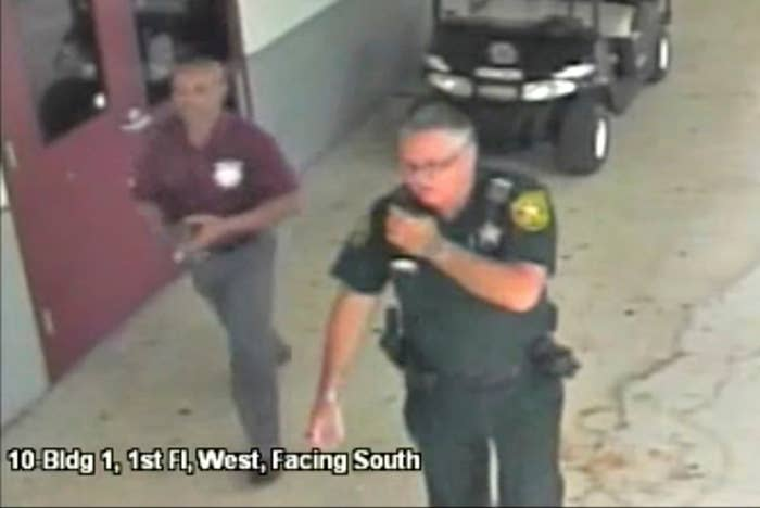 Scot Peterson is seen in this still image captured from the school surveillance video.