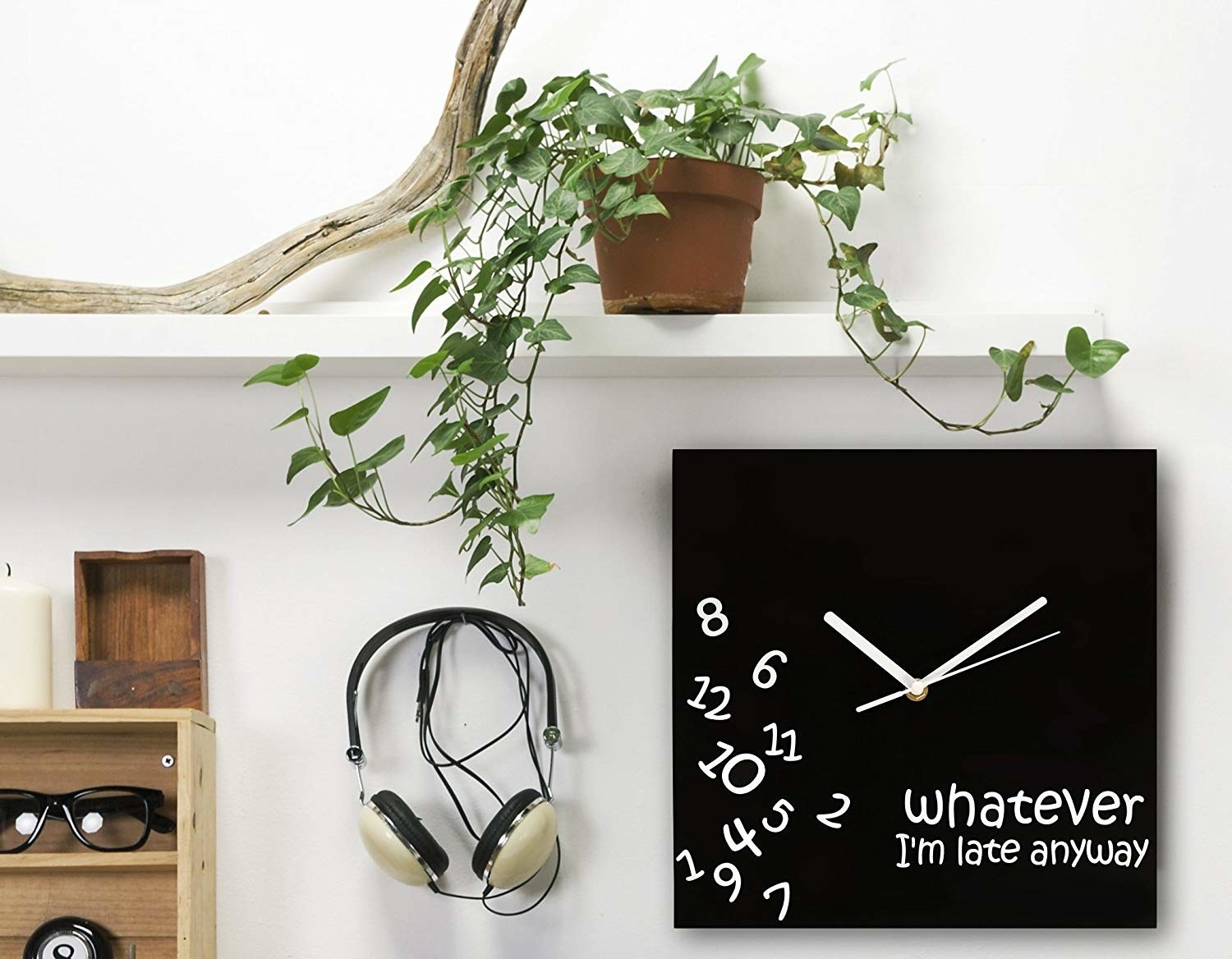 "A square wall clock with jumbled numbers and the phrase ""Whatever I'm late anyway"""