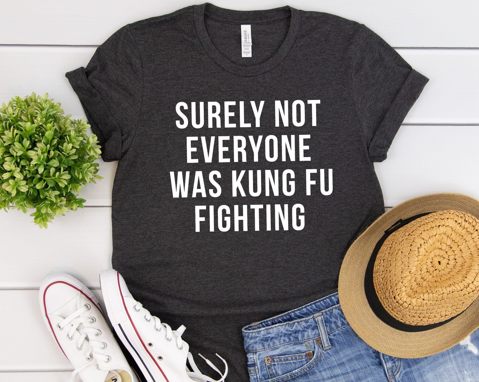 "A flat lay outfit shot showing the shirt that says ""Surely Not Everyone Was Kung Fu Fighting"""