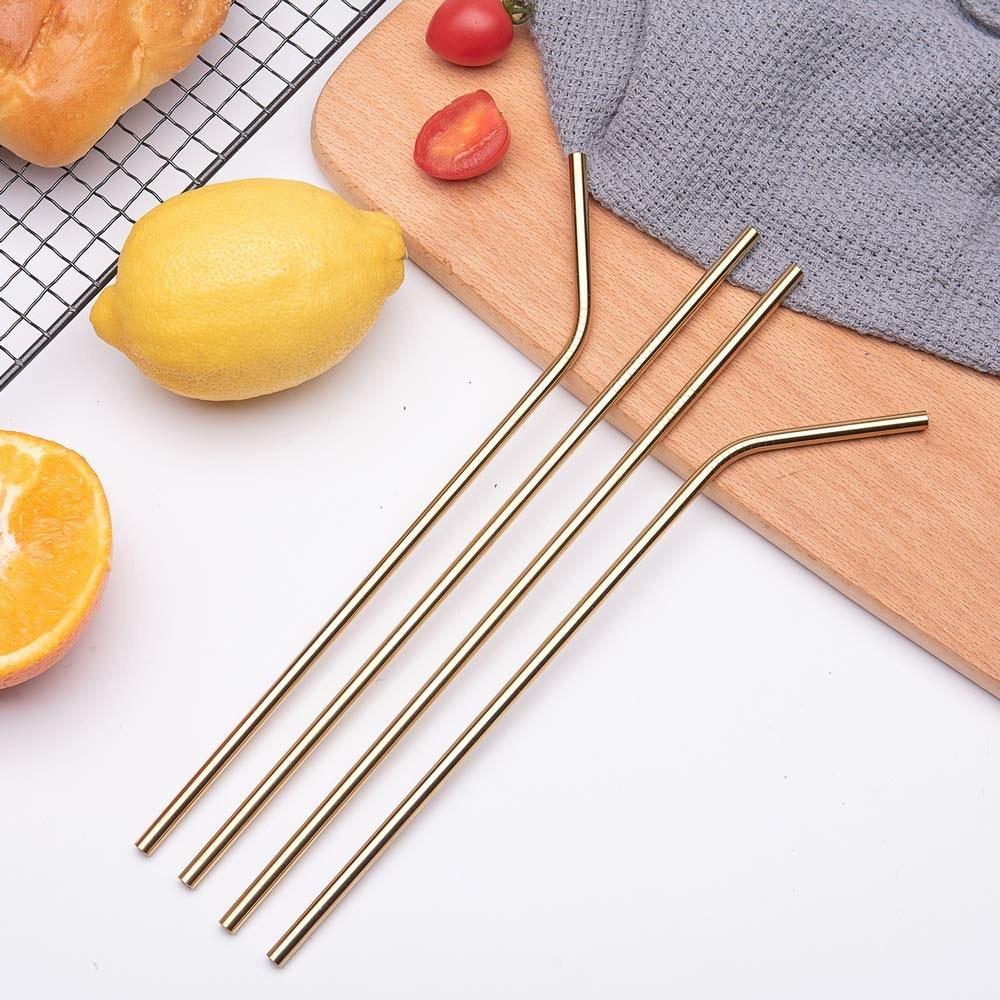 A set of four golden straws