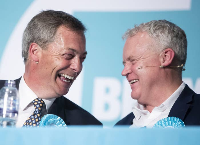 Brexit party leader Nigel Farage and candidate Mike Greene during a rally at the Broadway Theatre in Peterborough, UK.