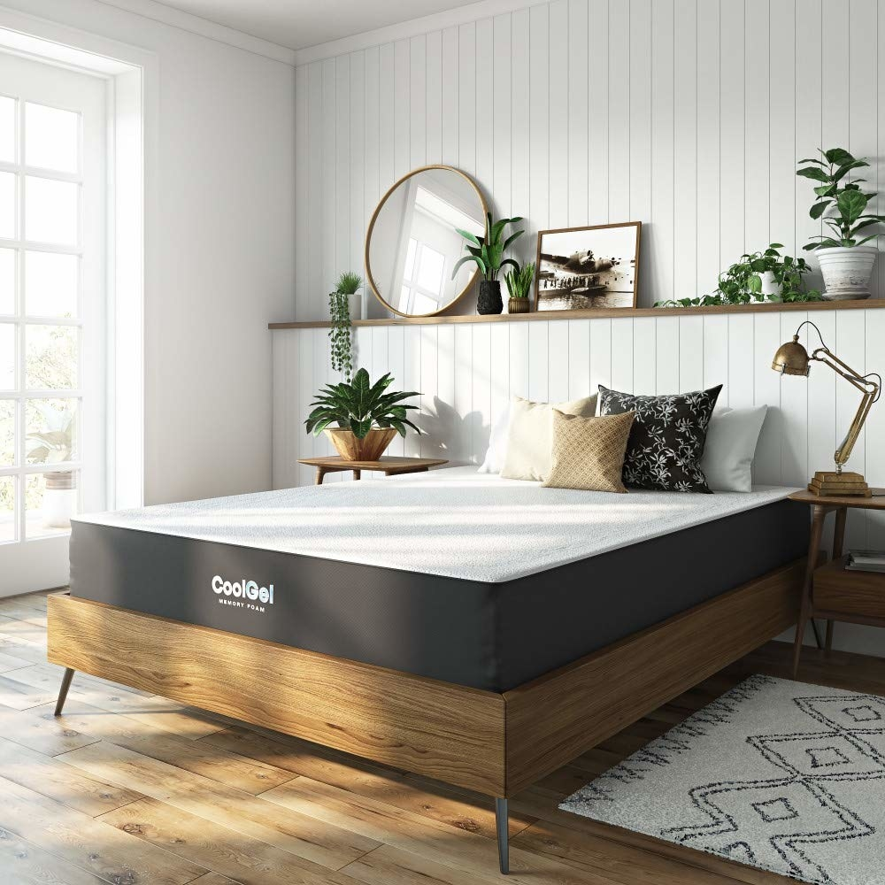 Plush mattress on top of bed frame