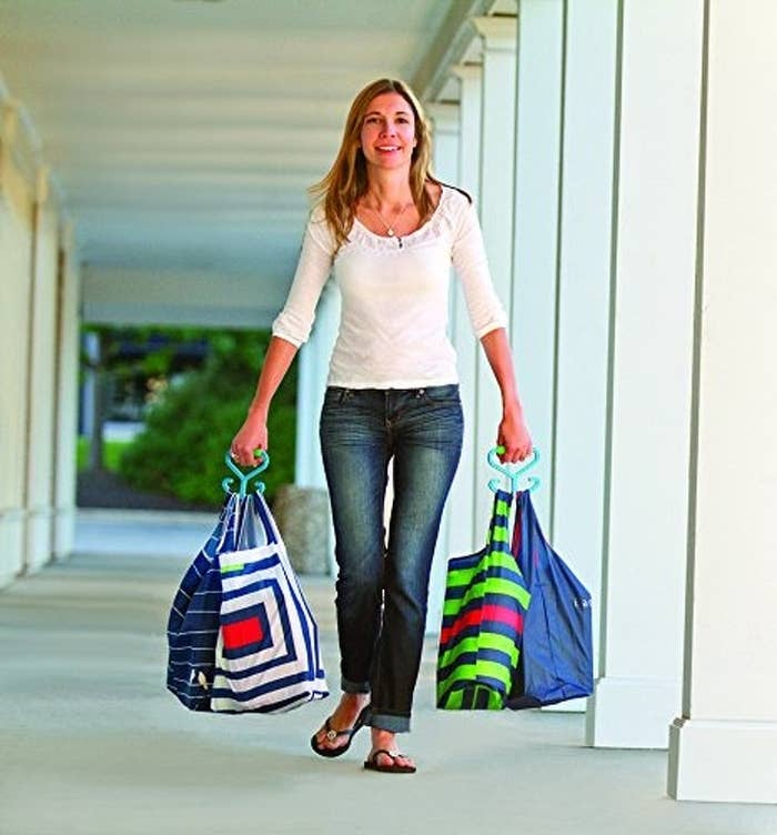 "Promising review: ""It usually takes me a dozen trips from my car to my house to get my groceries inside, and if I carry too many at once, the handles cut off the circulation in my hands and arms. These special handles solved all my problems. Today, I only made three trips from the car to the house! When I had to put the bags down to open the door, these handles laid on top of the bags and I only had to grab them, instead of searching for all the bag handles as they flopped around. Now there are no more bag marks on my wrist and my hands don't go numb! Who would have thought that something so simple could make my life so much better?"" —Rosemary Smith DattlerGet a set of two from Amazon for $9.99."