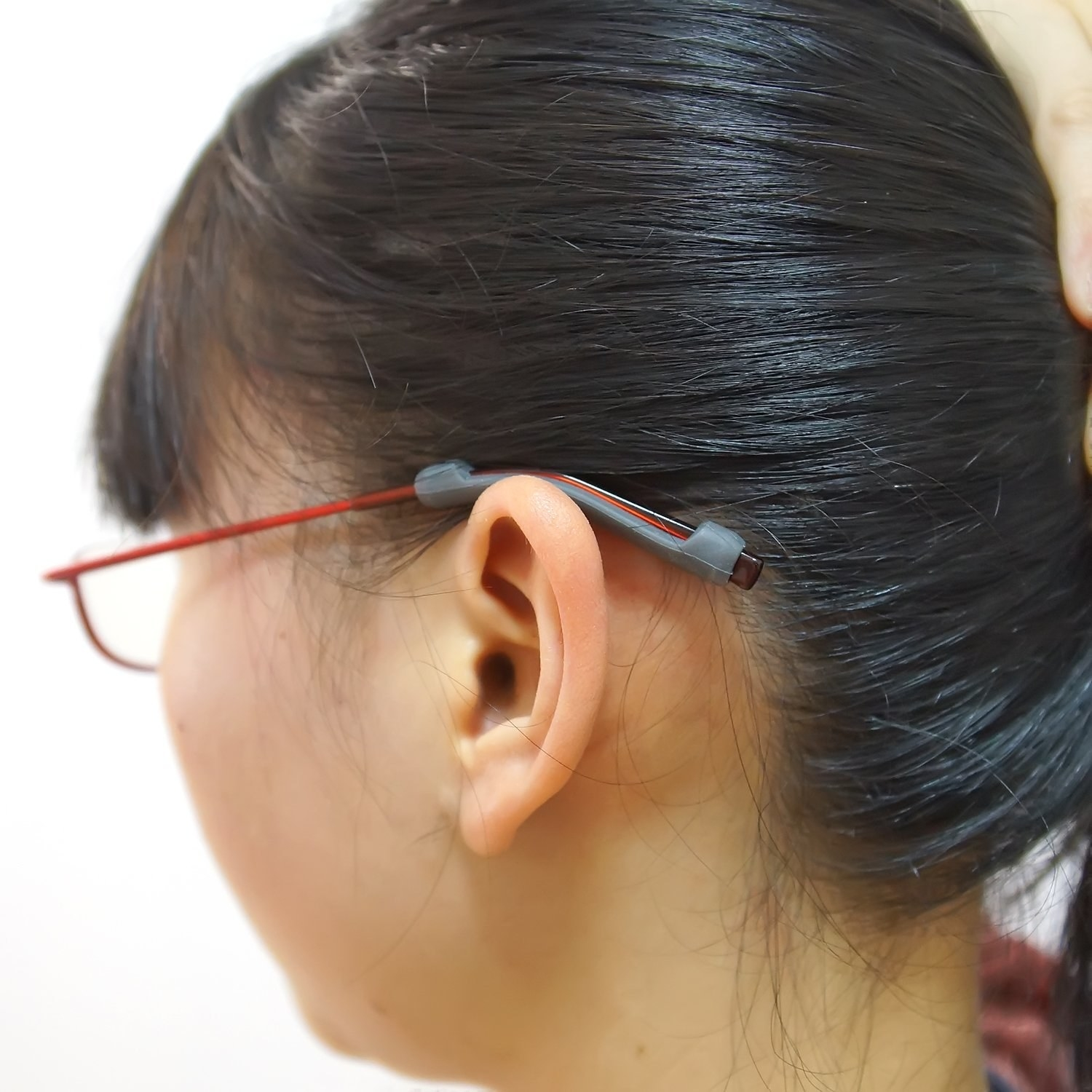 Woman wearing glasses with silicone grips