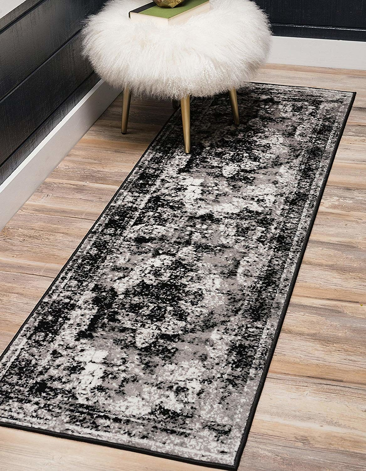 black, gray, and white rug runner with antique-inspired design
