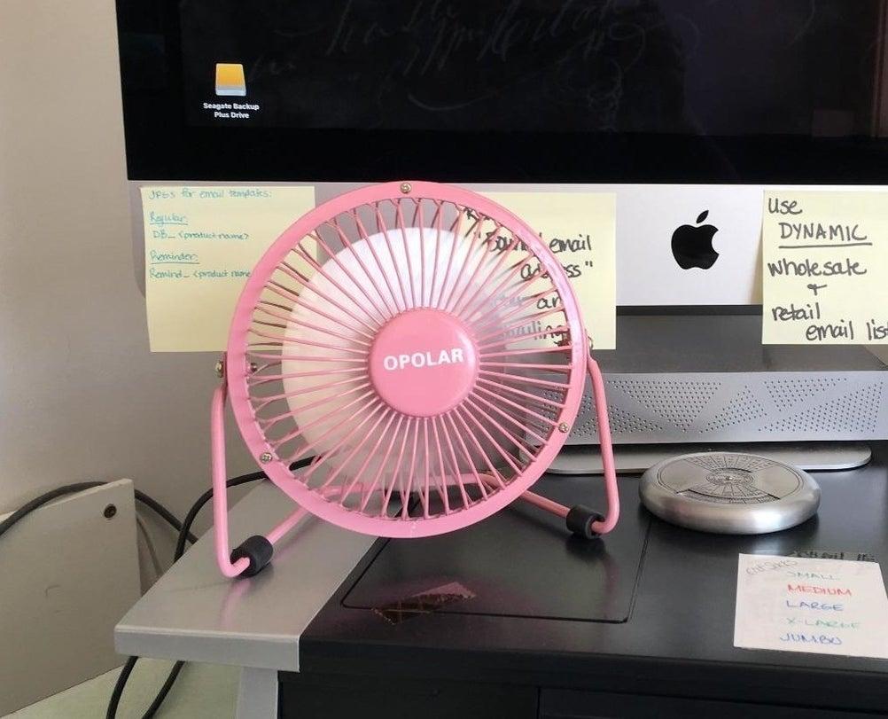 Mini pink fan placed on desk