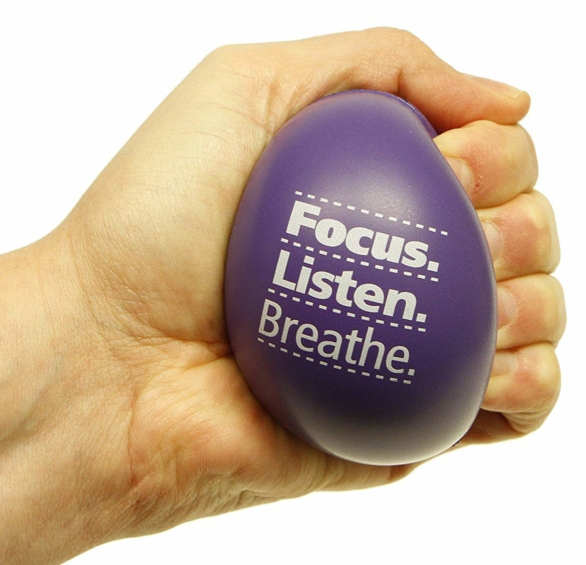 """Model squeezing stress ball with the words """"focus, listen, breathe"""""""