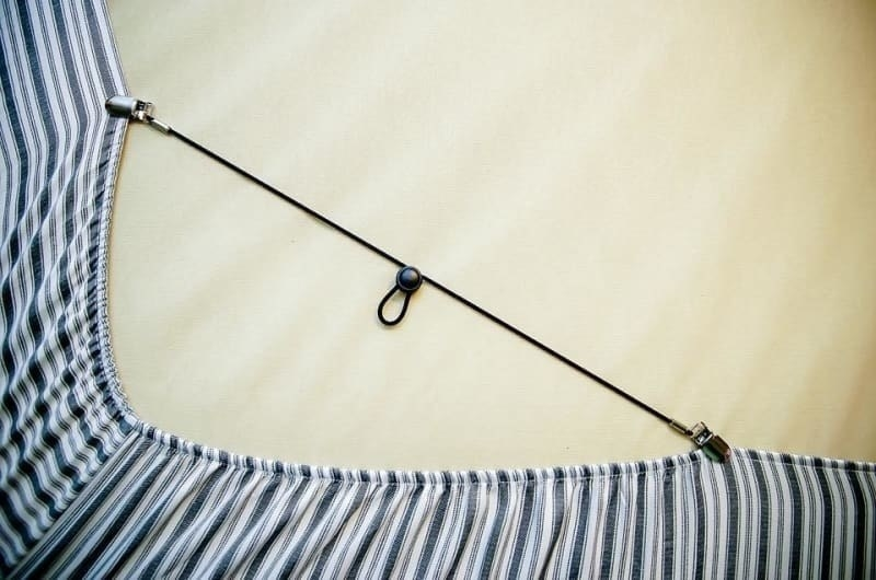Bed bands attached to sheets, holding them in place on a mattress
