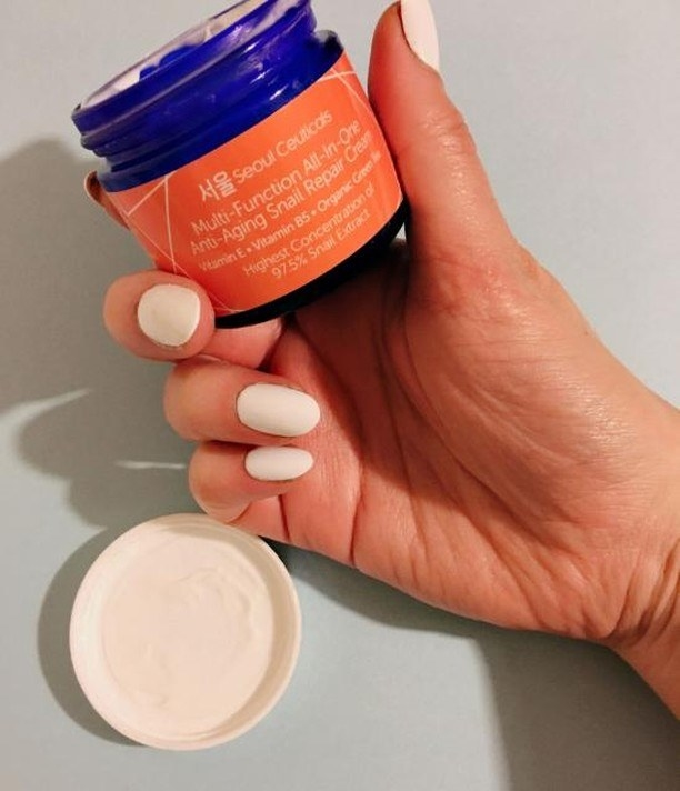Hand holding the moisturizer