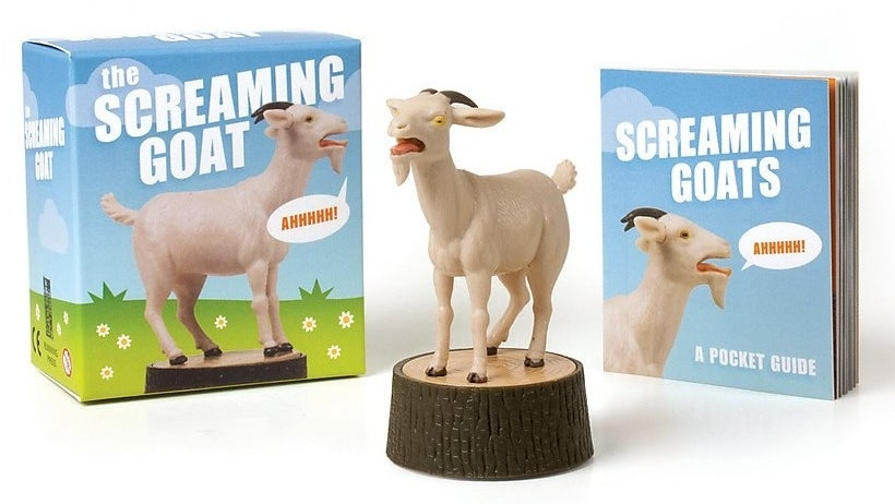 Screaming goat figurine next to box and mini booklet