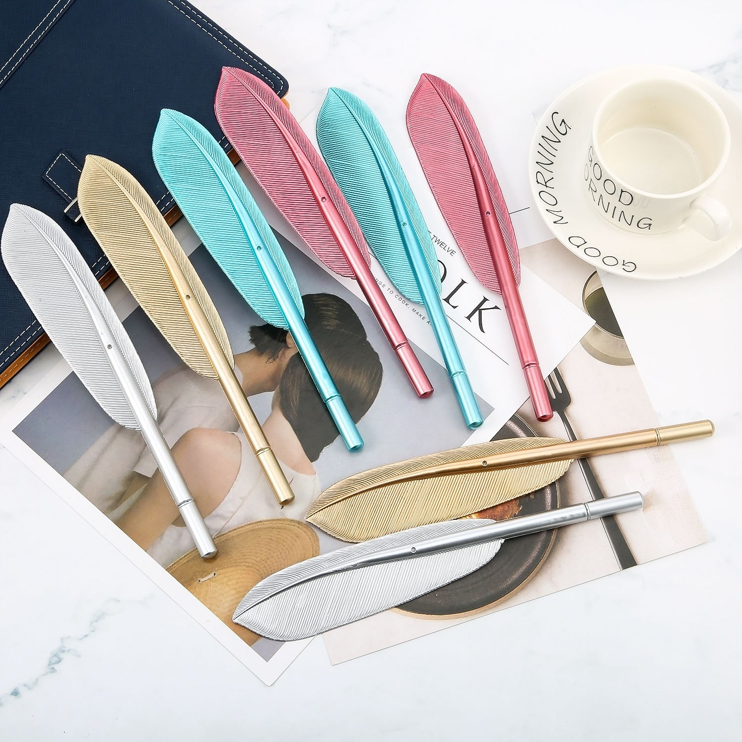 Six feather-shaped pens placed on desk