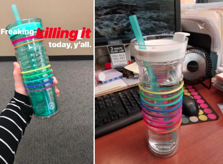 A reviewer photo of the water bottle with different colored rings moved up or down the bottle to indicate how many bottles they drank
